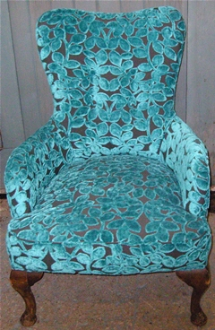 Chair upholstered in designer fabric