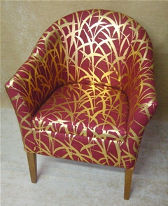 Tub chair upholstered in designer fabric